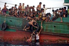 Rohingya migrants on a fishing boat, part of an exodus in which thousands of people took to the sea to flee ethnic persecution in Myanmar. 5/14/15, Andaman Sea off Thailand, by Christophe Archambault, Agence France-Presse. A selection of the year's most riveting photographs.