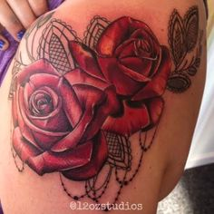 Lovely red roses and lace tattoo female by Meghan Patrick.