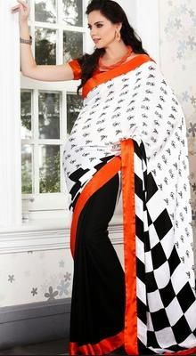 Outstanding craftsmanship of embellishments exhibited in this charming black, white faux georgette, satin & silk saree. It has been beautifully designed with block print work. #PrintedSaree #PrintedGeorgetteSaree