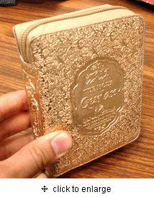 Pocket Quran - Arabic + English. Pretty gold zip cover : )