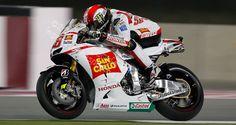 MotoGP Print - 2011 MotoGP's Marco Simoncelli #58 racing Honda's RC212V for Team San Carlo Honda Gresini MotoGP