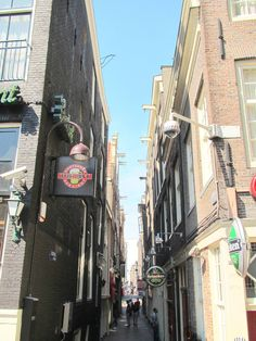 Little street in the Red Light District of Amsterdam: Stoofsteeg. In 1464 there were many one-room houses in this alley. Poor people lived there.