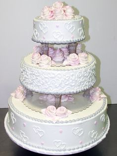 Love! Pink buttercream roses, gray beaded borders and white buttercream hearts on a traditional pound cake iced in buttercream
