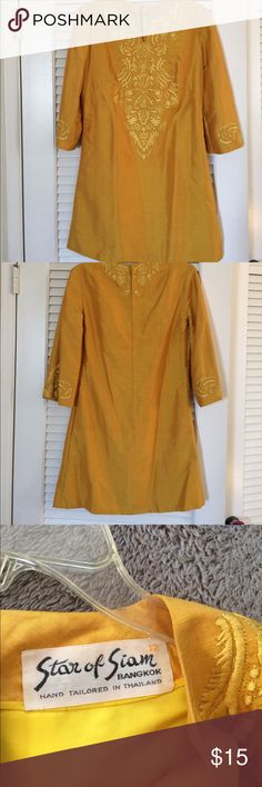 """Vintage silk tunic dress from Thailand.  Size 12 Vintage gold silk tunic dress from Star of Siam of Bangkok.  Embroidered with silk and gold thread.   Fully lined inside.  Zipper back.  32"""" long.  36"""" bust.  Shift style dress. Dresses Mini"""