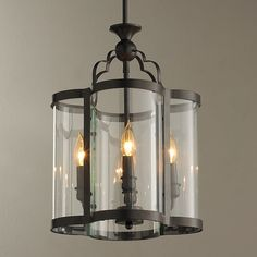 "A new twist on a classic glass conservatory lantern, this quatrefoil shaped light has curved glass panels that form a quatrefoil shape within the  blackened bronze frame.4x60 watts. (candle base socket). (17.5""Hx13""W). 12"" down rod, 5"" canopy included. OAH 31.5""."