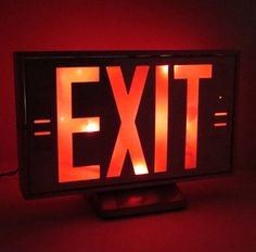 Fun piece of industrial salvage! This exit sign light is aluminum with red plastic insert. We have inserted a short string of 20 Christmas