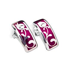 The Édua collection combines the designer's appreciation for traditional Hungarian style with her own contemporary flair, making its pieces a collage of the past and the present. Opposites attract, and the pieces of this collection exude sophisticated folk style and modern elegance. These stunning enamel and 925 sterling silver earrings are made using a high-tech German ceramic technology which guarantees solid durability and top quality finish. A strong rhodium layer protects wearers wit...