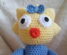 amigurumi plushie in the image of Maggie simpson/original pattern by bootneckbabies on Etsy