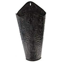 """Create your own unique decor inside this gorgeous Black Scroll Wall Container! The embossed swirl pattern on the outside is the perfect complement to your stylish home decor. Insert flowers, greenery and more to match your existing home or office decor!        Dimensions:          Length: 16 3/4""""    Width: 8 3/4""""    Projection: 3 1/2""""          Hanging hardware is attached."""
