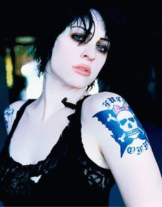 Margaret Sorrow- (Brody Dalle)She was a chronic kleptomaniac and inmate at Black Gate Prison. While serving her time in the prison, she took part in experiments in mind manipulation conducted by  Braxton and Ravencroft. They used a helmet-like device on her to wipe away her original memories and personality and re-worked them into a new personality.However, certain aspects of Sorrow's original personality resurfaced in the form of villainous Magpie.