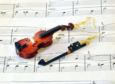 Hey, I found this really awesome Etsy listing at http://www.etsy.com/listing/105339539/violin-earrings-with-bow-in-case-viola