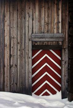 Red and white chevron door in Norway.  doors of the world. travel. Europe. Scandinavia. doors.