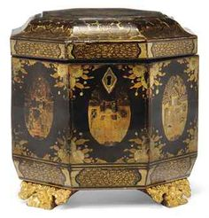Chinese Lacquer Hexagonal Tea Caddy, 19th century: Gilt on a dark background with panels of figures in courtyards, amid floral sprays, 4 giltwood floral feet, with pewter liner, ivory knop handle / http://www.christies.com/lotfinder/lot/a-chinese-export-lacquer-hexagonal-tea-caddy-19th-5410661-details.aspx#