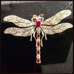 We love insect brooches here at AC Silver, and this stunning antique 5.70 carat diamond and 3.30 carat ruby, 9 carat yellow gold dragonfly brooch is definitely one of our favourites! The detailing of the design is just exceptional! SKU: W9350 Price: GBP £12950.00 http://www.acsilver.co.uk/shop/pc/5-70-ct-Diamond-and-3-30-ct-Ruby-9-ct-Yellow-Gold-Dragonfly-Brooch-Antique-Victorian-35p6390.htm#.VK_dkC6_AR0 #insect #dragonfly #ruby #diamond #victorian #antique #gold #brooch #jewellery