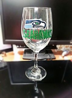 Seattle Seahawks hand painted wine glass! Cute idea! Order at https://www.facebook.com/MYLAFASHION