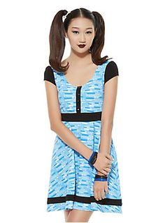 """<p>Transform into the joy and laughter aka Bubbles in this dress from the Hot Topic exclusive Powerpuff Girls collection. The design is inspired by her costume with a blue and white bubble-like print all over, black waistband, black cap sleeves, button accents and black bow accents on the back. Now you're ready to save the world... before bedtime!</p>  <ul> <li>35"""" long</li> <li>96% polyester; 4% spandex</li> <li>Wash cold; dry low</li> <li>Imported</li> </ul>"""
