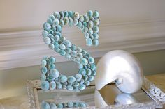 $58. nope. Craft store letters, hot glue, shells from kids beach trip, spray paint. Awesome for center of wreath, fraction of cost, kids get to help!