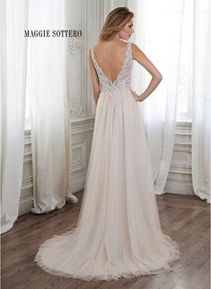 Tulle A-line wedding dress with romantic lace bodice, accented with Swarovski crystals. Westlyn by Maggie Sottero.