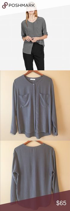 """Everlane 100% silk long sleeve blouse Like new Everlane 100% silk, long sleeve blouse with double pockets. Versatile, buttery soft, crepe-de-chine grey silk. Front measures 22"""". Back measures 28.5"""" Everlane Tops Blouses"""