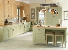 Moen - Traditional - Kitchen - Moen  I would make all the cabinets that sage green and do a dark hardwood floor. But love the general idea!