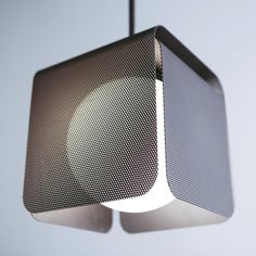 The Veil Pendant Light by features a sleek silhouette that conveys the elegant appearance of modern design. Faintly concealing the light source on five sides are screens made of perforated steel. Emitting within the cube is a hand-blown glass glob Design Light, Modern Lighting Design, Lamp Design, Interior Lighting, Home Lighting, Pendant Lighting, Lighting Ideas, Lighting Stores, Modern Pendant Light