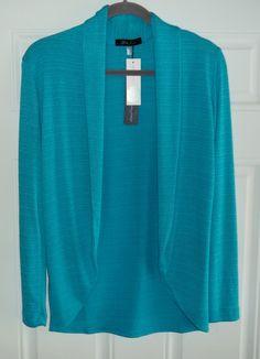 January 2016 Stitch Fix. Laila Jayde Malaga Drape Cardigan in Turquoise. Very soft 70% Rayon 24% Polyester 6% Spandex.  https://www.stitchfix.com/referral/4292370