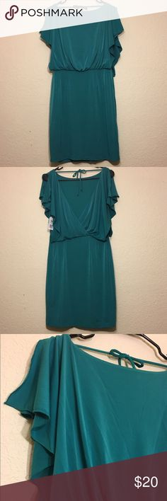 Jessica Simpson Open Back Jersey Dress 👗 Lovely Jessica Simpson turquoise open back dress. Beautiful draped sleeves and back with tie. 96% polyester 4% spandex. Lining is 100% polyester. New with tags. Has a very small hole on the front of the skirt, hardly noticeable with how fluid the dress is. Jessica Simpson Dresses Midi