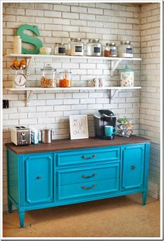 Not a huge fan of brightly painted furniture, but I liked this styling.  It feels like an industrial version of a coffee/baking center or china cabinet.  Great glazed brick.