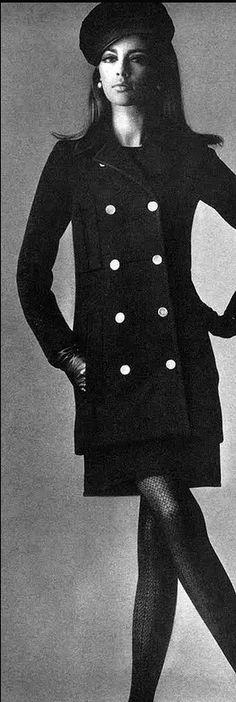 1966 Astrid Heeren in classic Yves Saint Laurent brass-buttoned coat, photo by Penn