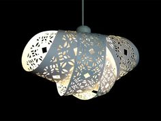 Lampshade created by overlaying strips of etched paper.  |  From CutandPaste