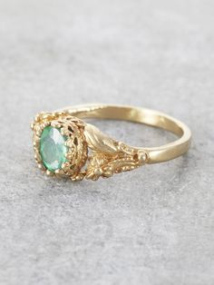 A lush Golden Garden of delicately detailed wild flowers and gracefully winding leaves, reveals a precious, crowned Emerald jewel. This would make an exceptional & unique Engagement Ring. Set in Solid Sea Glass Jewelry, Silver Jewelry, Vintage Jewelry, Fine Jewelry, Silver Rings, Vintage Gold Rings, Craft Jewelry, Antique Jewellery, Vintage Silver