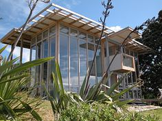 Melling Morse Architects ltd  The Split Box residence in Tuateawa Bay, Coromandel, New Zealand adapts the traditional bach materials, wood and corrugated iron into a spectacular two storey loft. The forward glazing and open planned layout, wouldn't look out of place in a down town Wellington penthouse. Yet here, the expanses allow undivided attention to the beach and are used to passively heat the concrete slab, which releases it's warmth in the evening. To compensate in mid summer,...