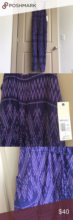 NWT Roxy Jumpsuit Brand new with tag Roxy jumpsuit. Purple print, tank top with tie to cinch waist. 2 front pockets near hips. Length: 58in shoulder to hem, 28in inseam. 100% viscose, light and airy material (not see through). Size small. Roxy Pants Jumpsuits & Rompers