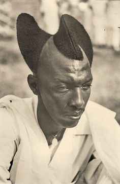An amazing example of the Amasunzu, a traditional hairstyle from Rwanda