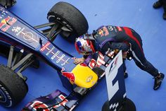 Korean Grand Prix - Sunday 6 October.  Sebastian Vettel strokes his car after the race.