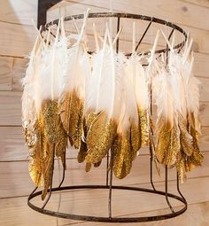 feather chandelier. The gold-tipped idea is cute for the gold-accenting.