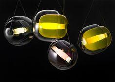 Designer Lucie Koldova has created a glass pendant light called Capsula for manufacturer BROKIS.