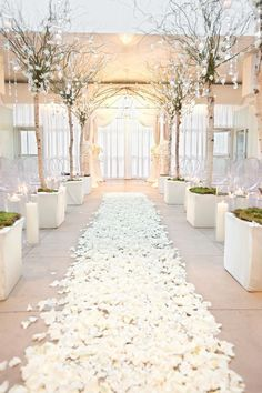 aisle of white rose petals and branches dripping with crystals / http://www.himisspuff.com/simple-elegant-all-white-wedding-color-ideas/3/