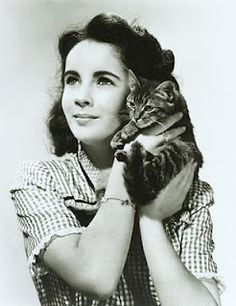 A young Elizabeth Taylor and one of many pet's