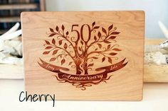 50th anniversary commenoratuve tree, engraved personalized cutting board makes a wonderful special gift for an anniversary. The cutting board may be customized with the first names and date of the couple celebrating their anniversary and is available in: Maple, Walnut or Cherry. This cutting board is 9 x 12 x 3/4. Which makes an excellent choice for a chopping board! One side is engraved for displaying.... while the back is left untouched for cutting/chopping.  **** Add a vintage to...