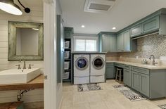 Transitional Laundry Room with Built-in bookshelf, limestone tile floors, Wall sconce, Farmhouse sink, High ceiling, Carpet