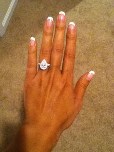 this is what i want. 1 or 2 carat pear center stone, with a micro halo and diamonds around the setting too. preferably platinum. SO PRETTY :)