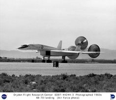 https://flic.kr/p/8BwvPu | XB-70A landing with drag chutes deployed | This photo shows the XB-70A #1 rolling out after landing, employing drag chutes to slow down. In the photo, the outer wing panels are slightly raised. When the XB-70 was flying at high speed, the panels were lowered to improve stability. The XB-70 was the world's largest experimental aircraft. It was capable of flight at speeds of three times the speed of sound (roughly 2,000 miles per hour) at altitudes of 70,000 feet…