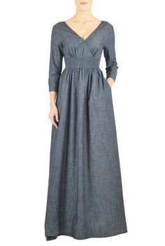 Our indigo chambray dress is cut at floor length with a flirty surplice V-neck and flattering elastic smocked Empire waist. Ruched pleating at the bodice and waist add subtle feminine detail.