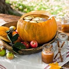 Cute idea~ fill a hollowed out pumpkin w/ apple cider. Apple slices & cinnamon sticks for garnish and served in canning jars for glasses...