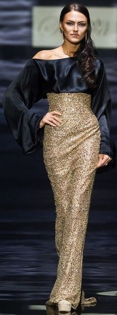 Alexandra Serova - black and gold gown