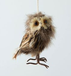 http://www.thetreetopper.com/wp-content/uploads/2012/11/Tussled-Feather-Owl-Ornament-Anthropologie-2012.jpg
