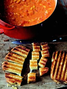 Best and easiest tomato soup recipe ever. Ina Garten's Easy Tomato Soup & Grilled cheese croutons. Unless it's for company we usually just go the grilled cheese sandwich route on whole wheat instead of the croutons. I also leave out the orzo for GF and sub basil (fresh or dried, as much as you want) for the saffron unless it's a special occasion.