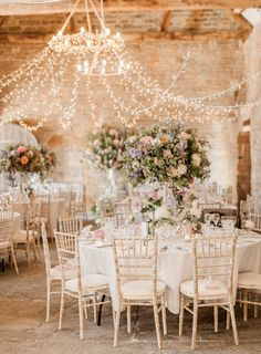 barn romantic wedding with tall centerpieces and stringlights decor
