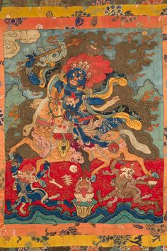 Magzor Gyalmo, Queen who repels armies is a wrathful emanation of the goddess Sarasvati and the special protector of the Dalai Lamas. 18th C.  Mongolia. applique with pearls, coral, horsehair, and gold thread.Rubin Museum of Art